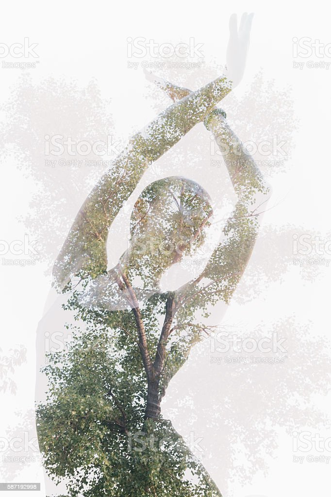 Double exposure portrait of dancing woman combined with tree photography stock photo