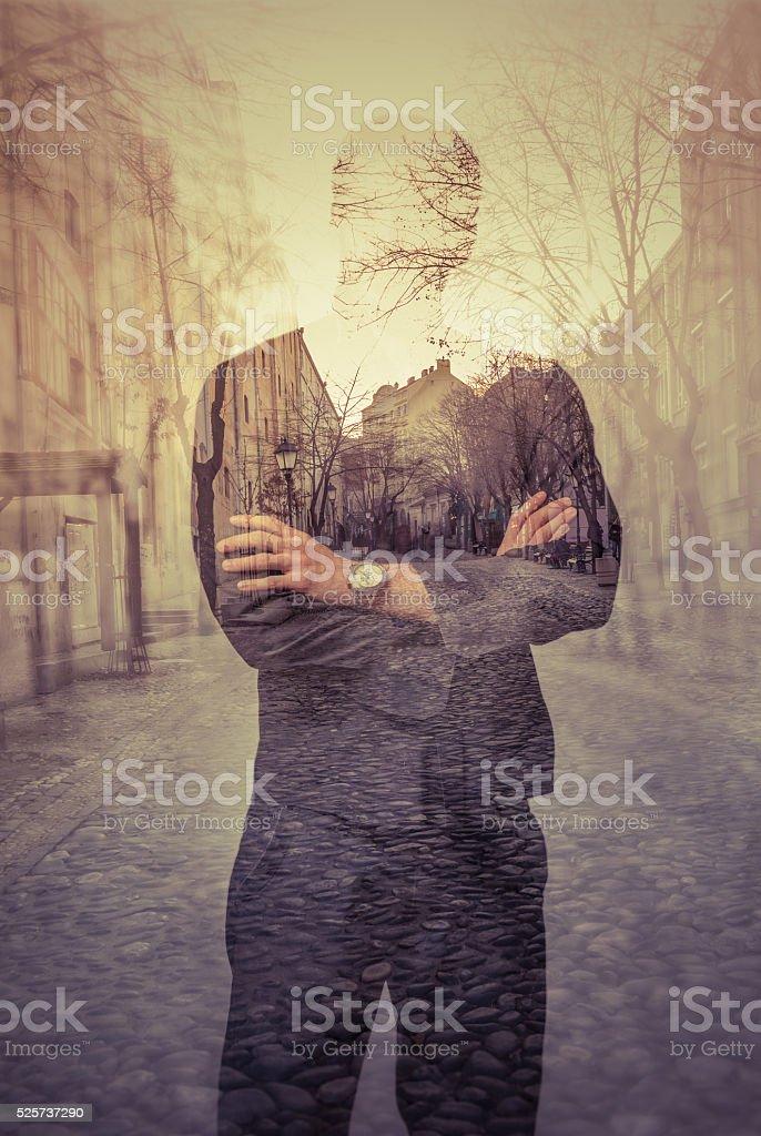 Double exposure portrait of unrecognizable man stock photo