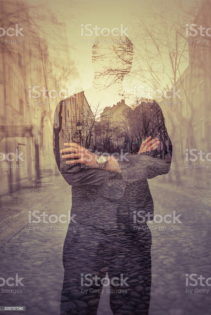 Double exposure portrait of unrecognizable man stock photo