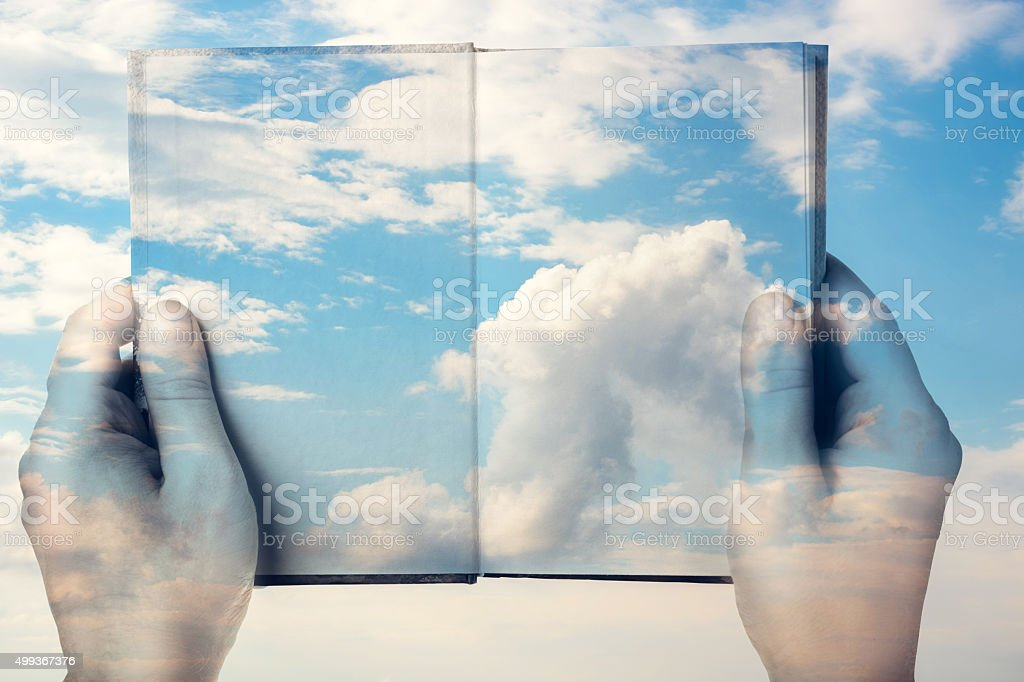 Double exposure. The book and the sky stock photo