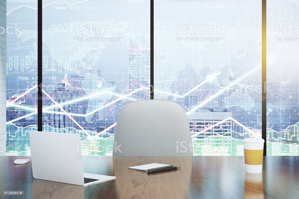 Double exposure with modern desk and business charts stock photo