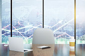 Double exposure with modern desk and business charts