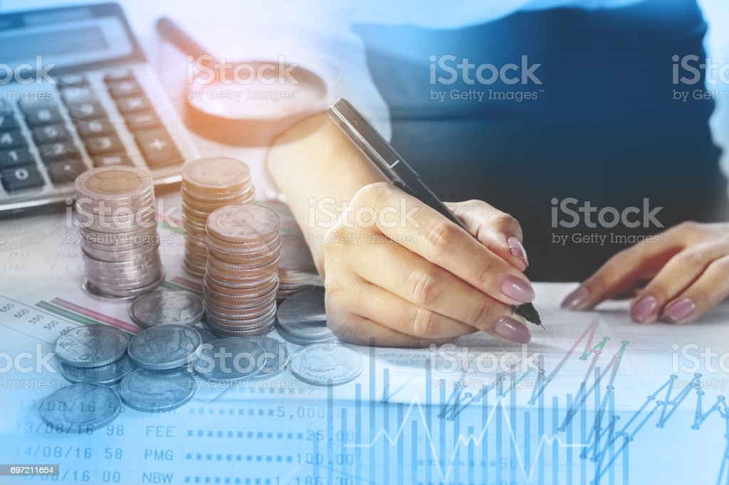double exposure working woman analyzing on business graph with coin,saving account stock photo