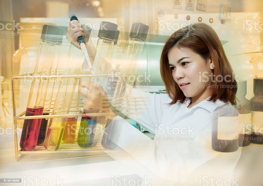 Double exposure Young female tech or women science working stock photo