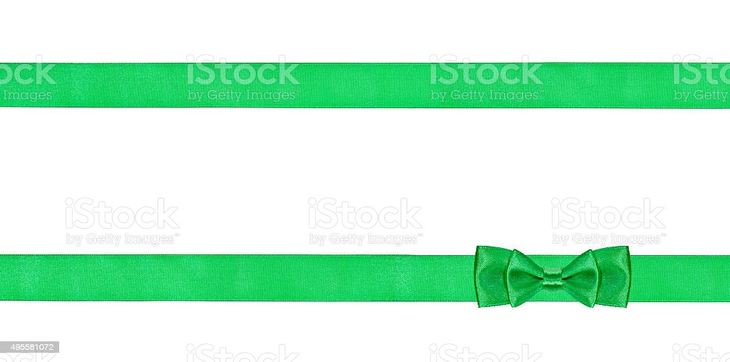 double green bow knot on two parallel silk ribbons stock photo