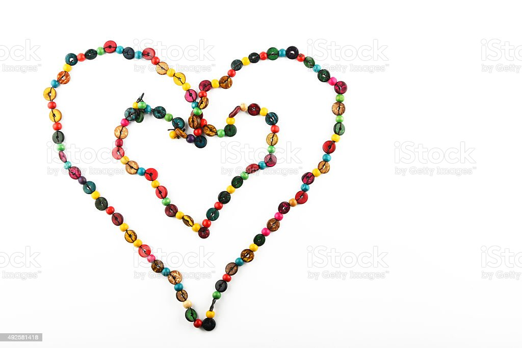 Double heart shaped colorful wooden beads necklace isolated on white royalty-free stock photo