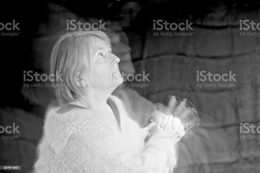 Double image of woman, pleading stock photo