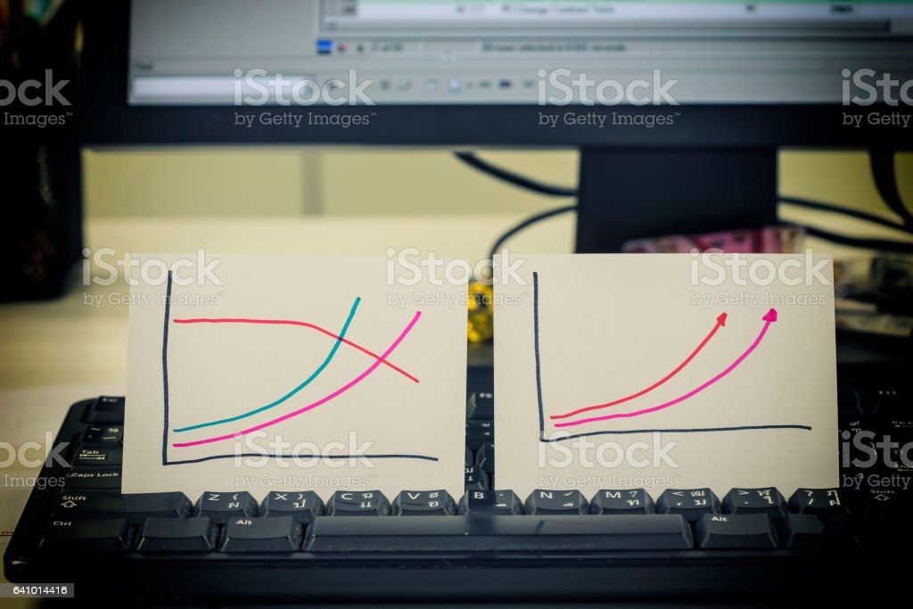 double manual graph on keyboard and monitor stock photo