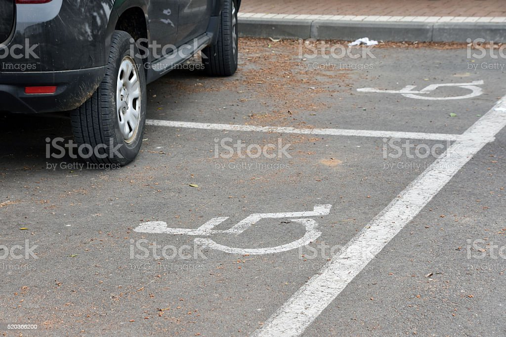 Double parking on Handicapped parking spots stock photo