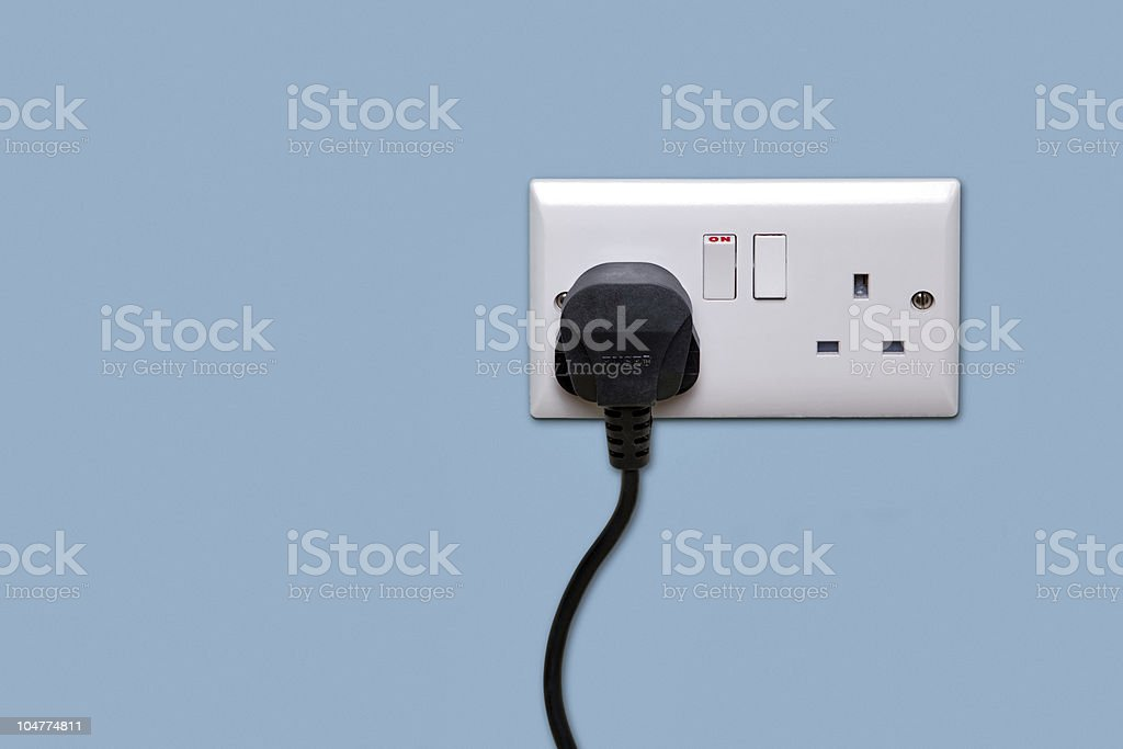 Double power socket and single plug switched on royalty-free stock photo