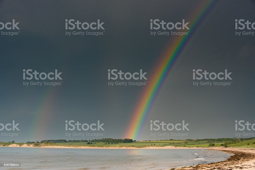 Double rainbow in Alnmouth Harbour, Northumberland UK stock photo