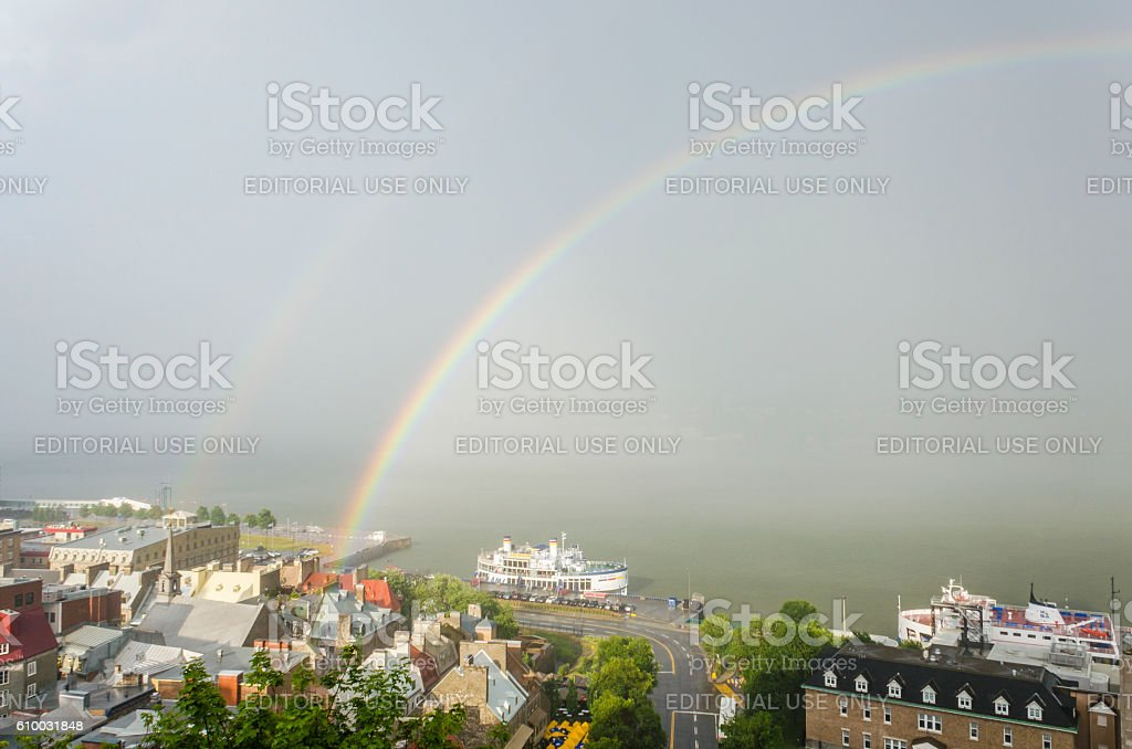 Double rainbow in downtown with view of Saint Lawrence river stock photo