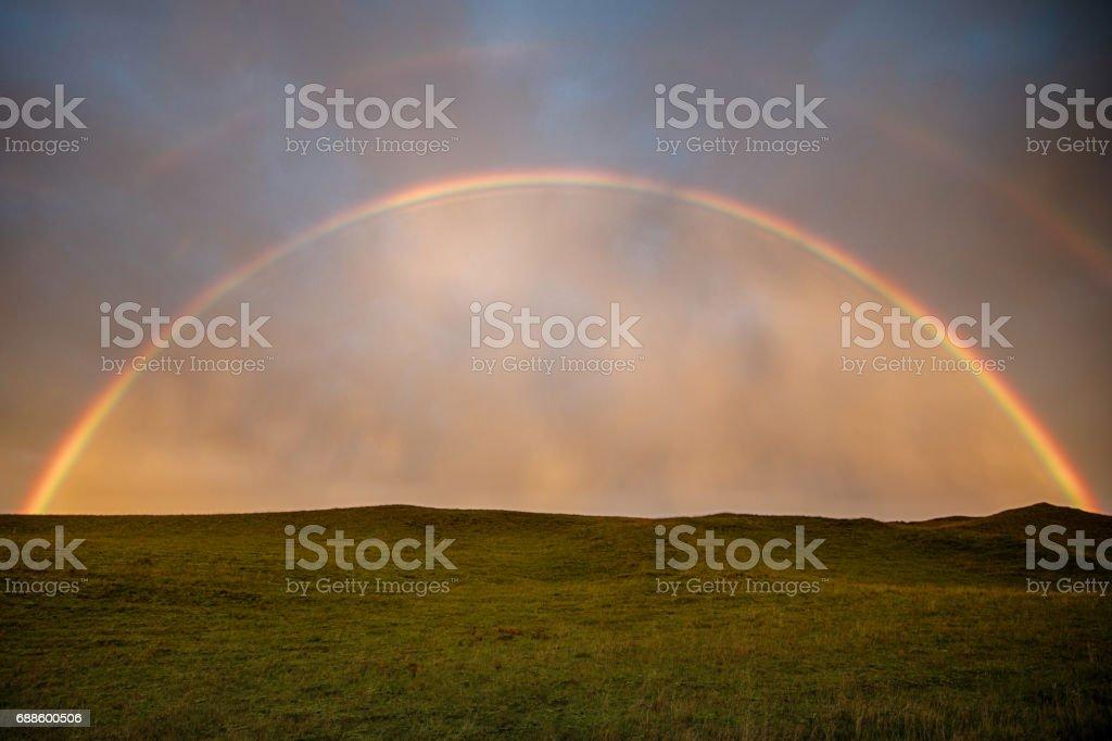 Double rainbow on a field stock photo