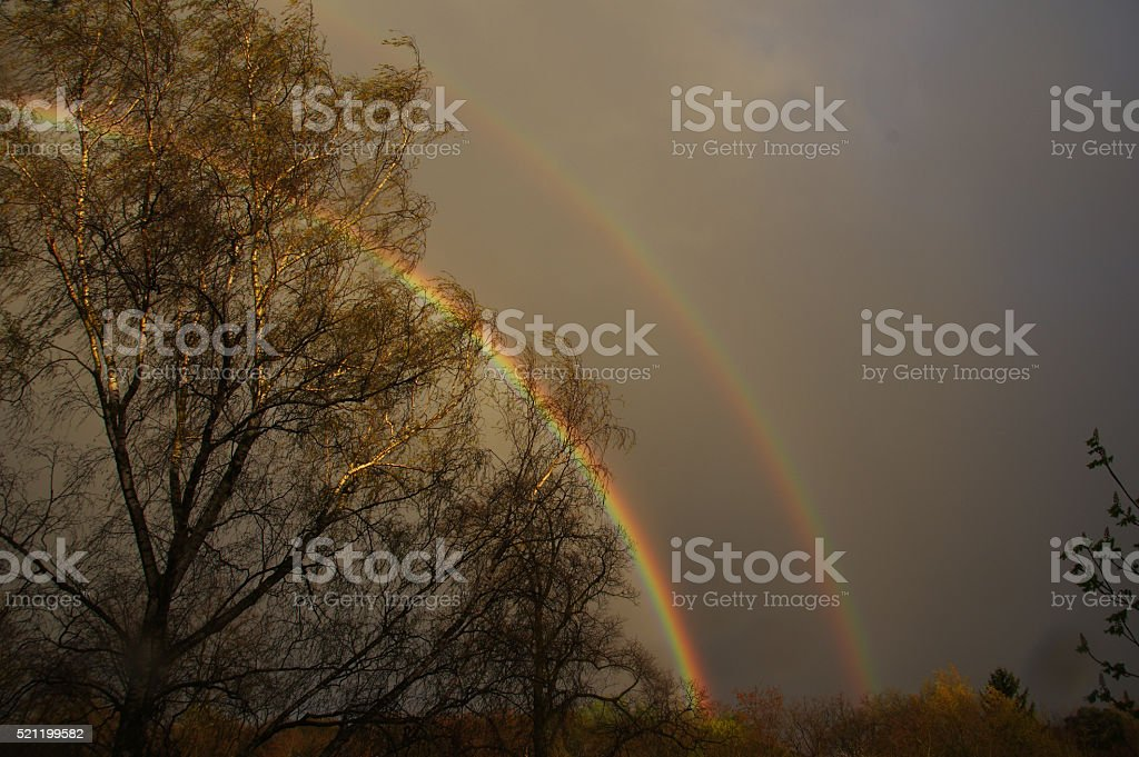 Double rainbow over the country stock photo