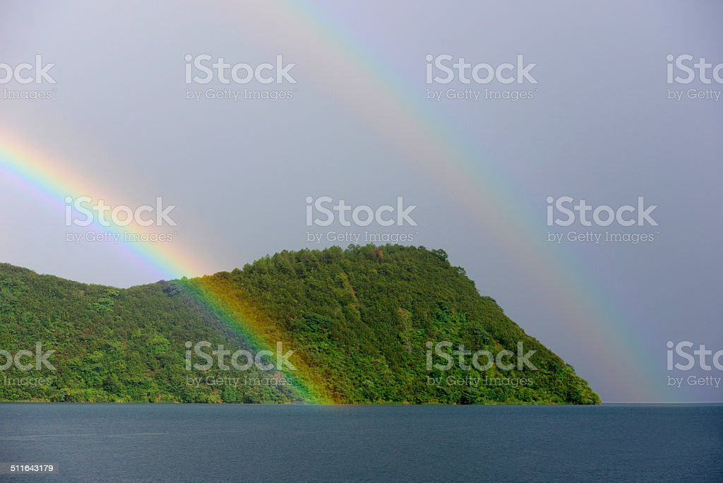 Double Rainbow over the Green Hills stock photo