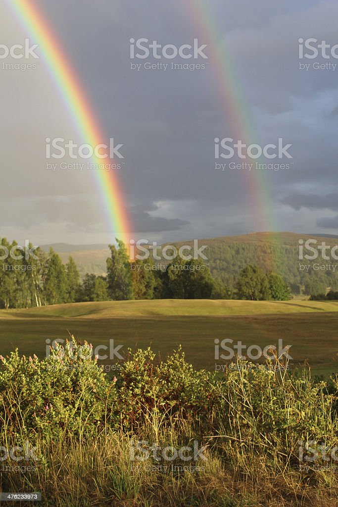 Double rainbow over the hills royalty-free stock photo