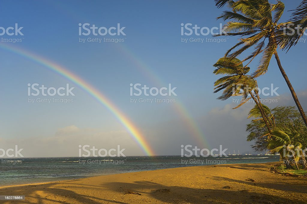 Double Rainbow over Tropical Ocean stock photo
