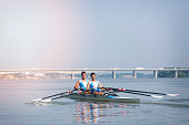 Double scull rowing on river