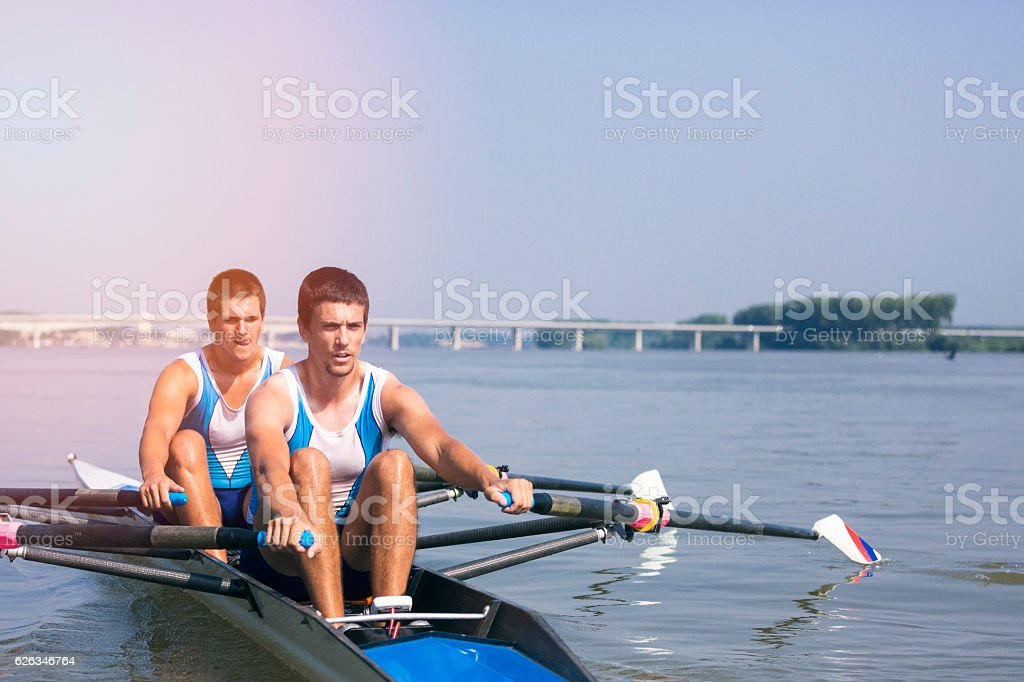 Double scull rowing on the river stock photo