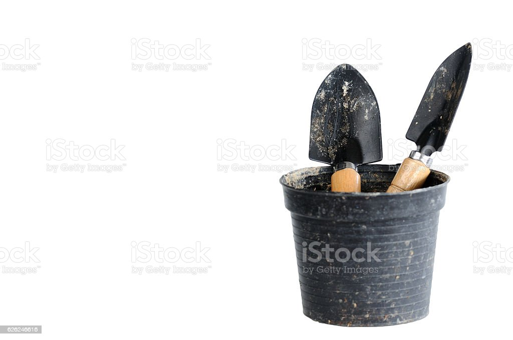 Double small shovel in plastic pot stock photo