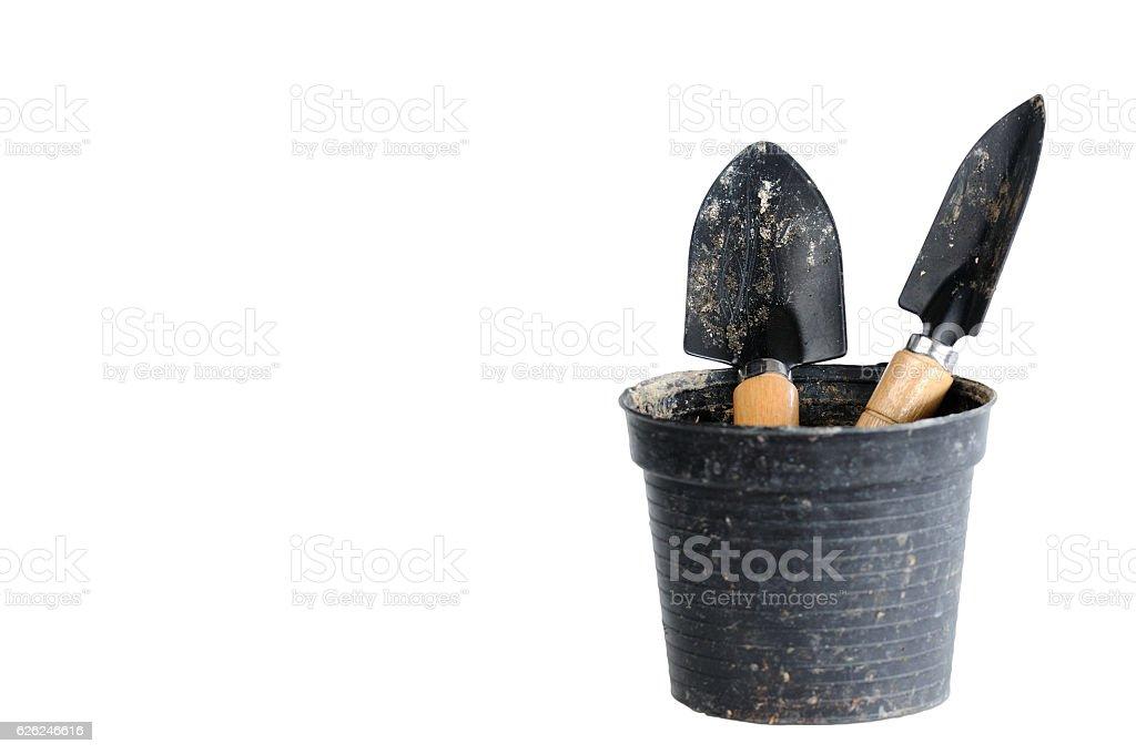 Double small shovel in plastic pot stock photo