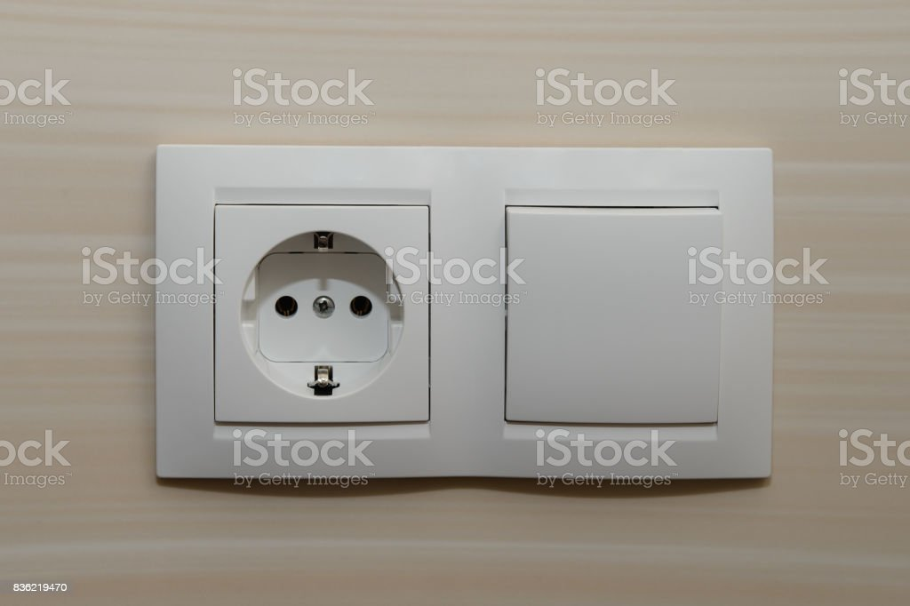 Double socket with a switch on the wall of tiles stock photo