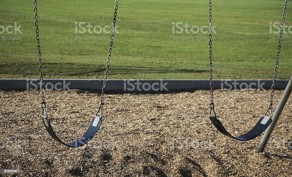 Double swings stock photo