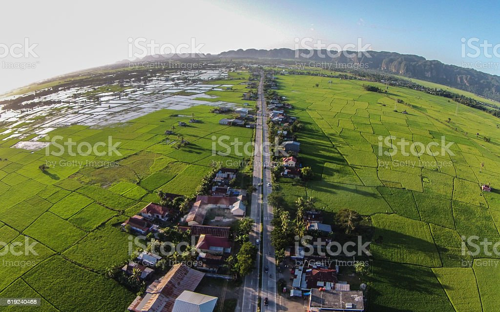 Double Track Highway in Green Rice Field South Sulawesi Indonesia stock photo