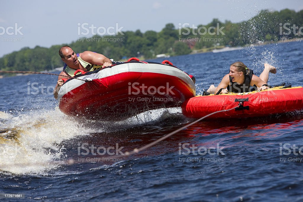 Double tubing fun. stock photo
