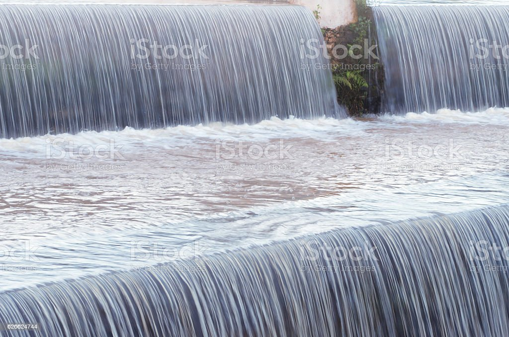 Double waterfall of a lake. Artificial water falling stock photo