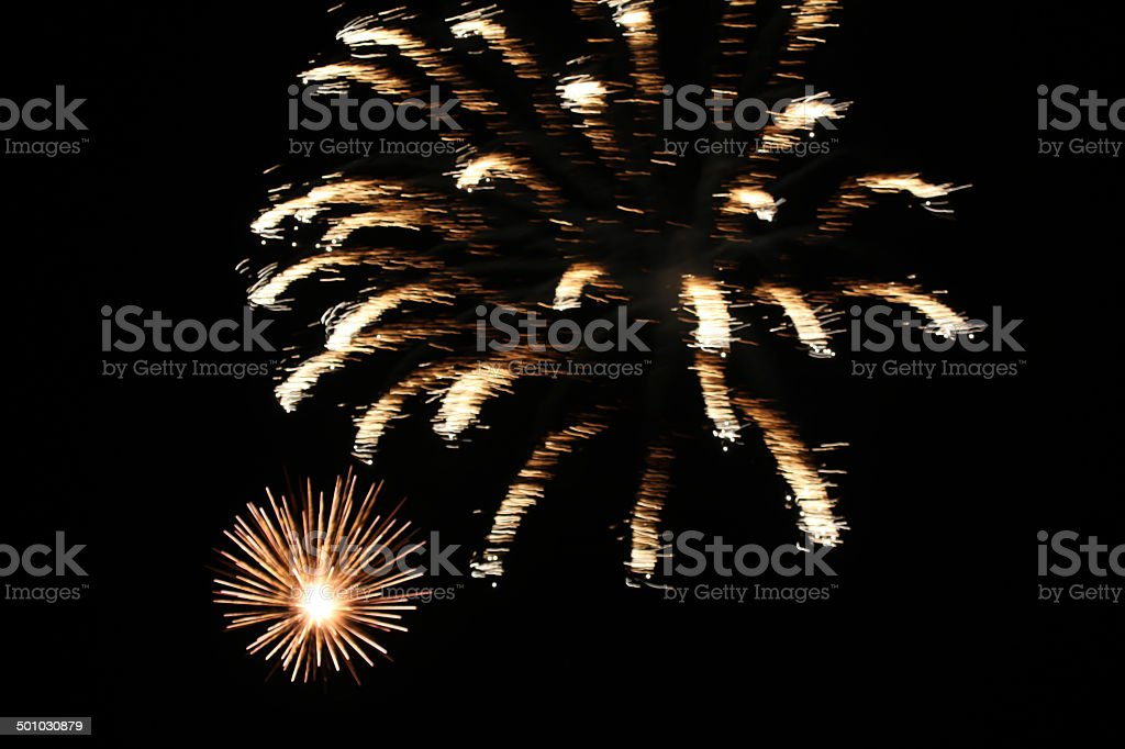 Double white and golden fireworks against all black sky.  Horizontal. royalty-free stock photo