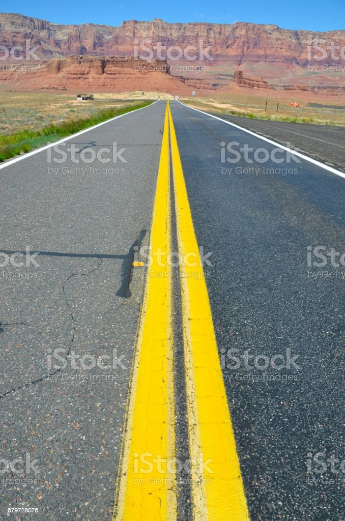 Double Yellow Line at the Road in Vermillion Cliffs , Arizona stock photo