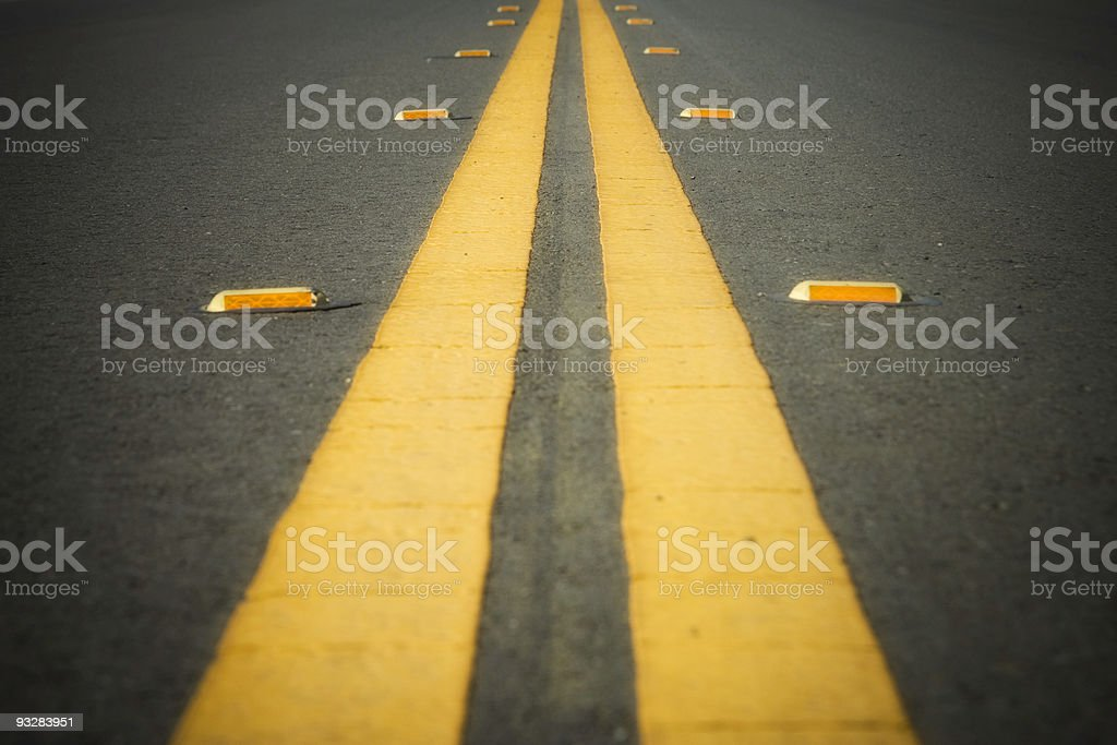 Double Yellow Line on a Road stock photo