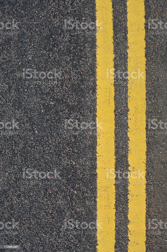 Double yellow line on grey pavement royalty-free stock photo