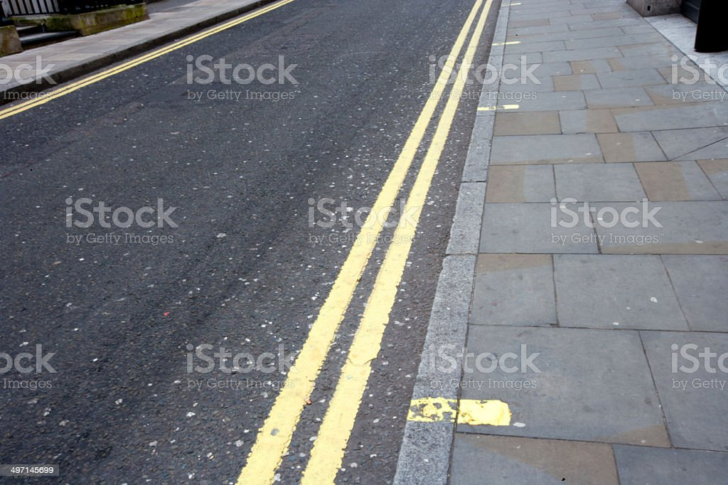 Double yellow line on London street stock photo