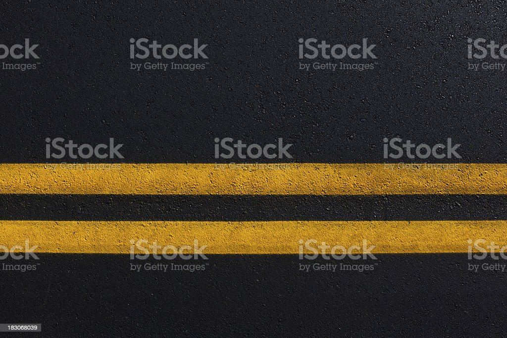 Double Yellow Line On New Asphalt Road stock photo