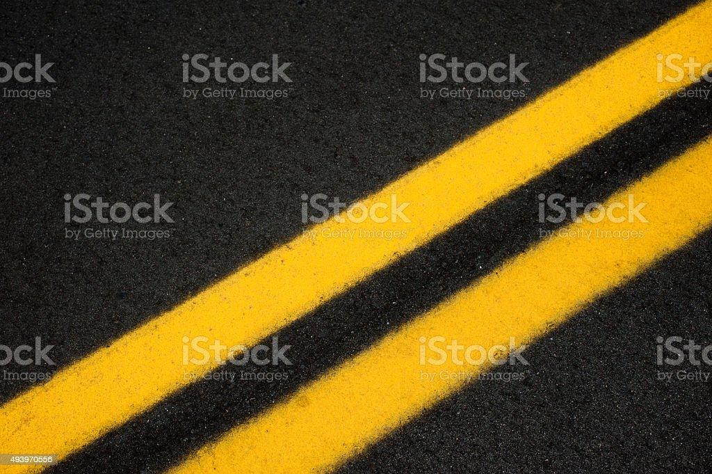 Double yellow line on pavement stock photo