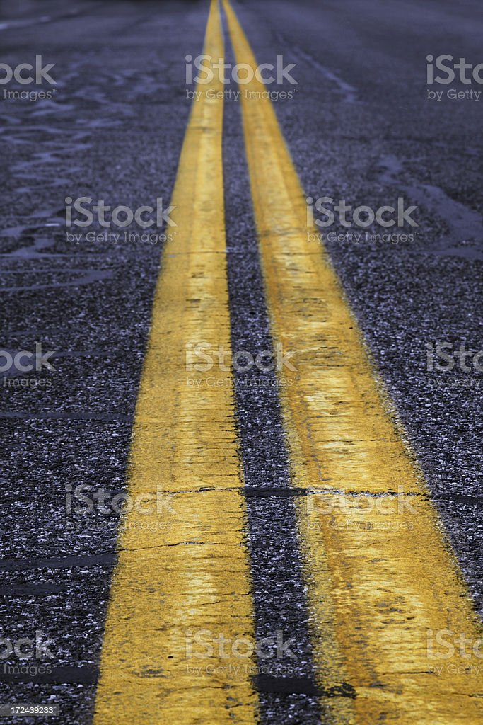 Double yellow line perspective royalty-free stock photo