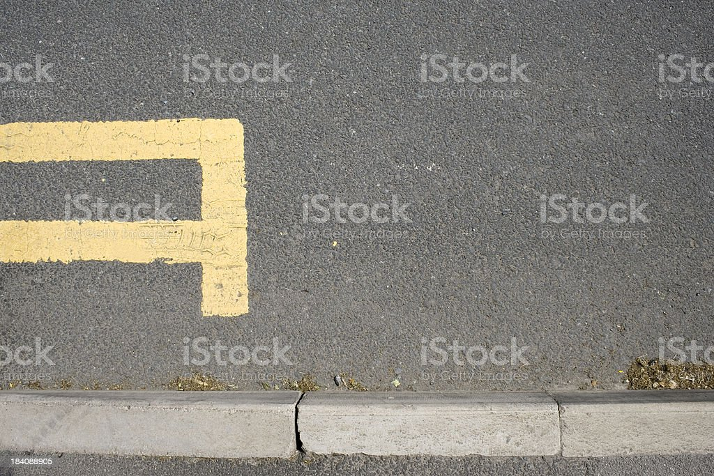 Double yellow lines end stock photo