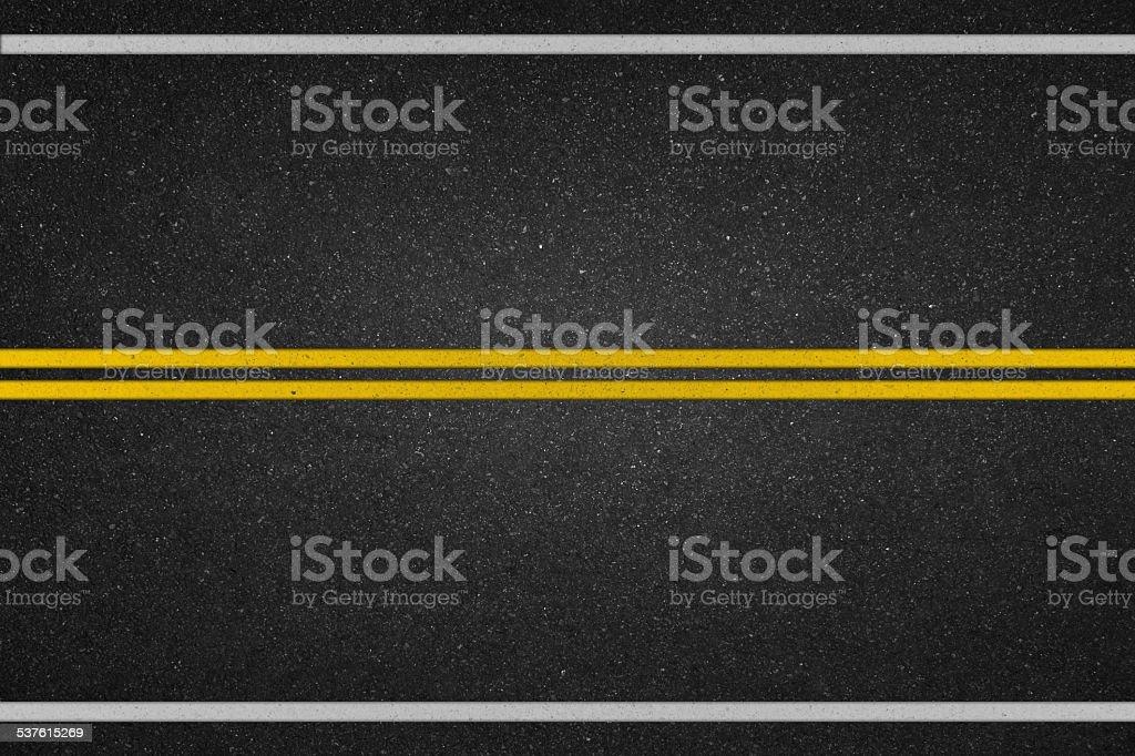 Double yellow lines on asphalt road stock photo