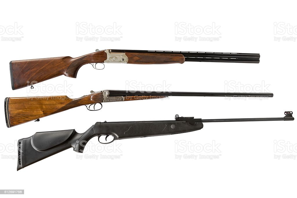 double-barreled shotguns and air gun isolated on white background stock photo