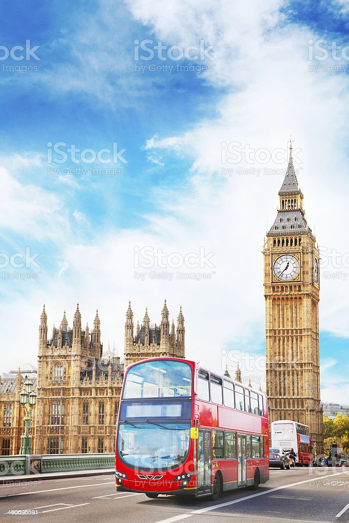 Doubledecker bus and Houses Of Parliament in London stock photo