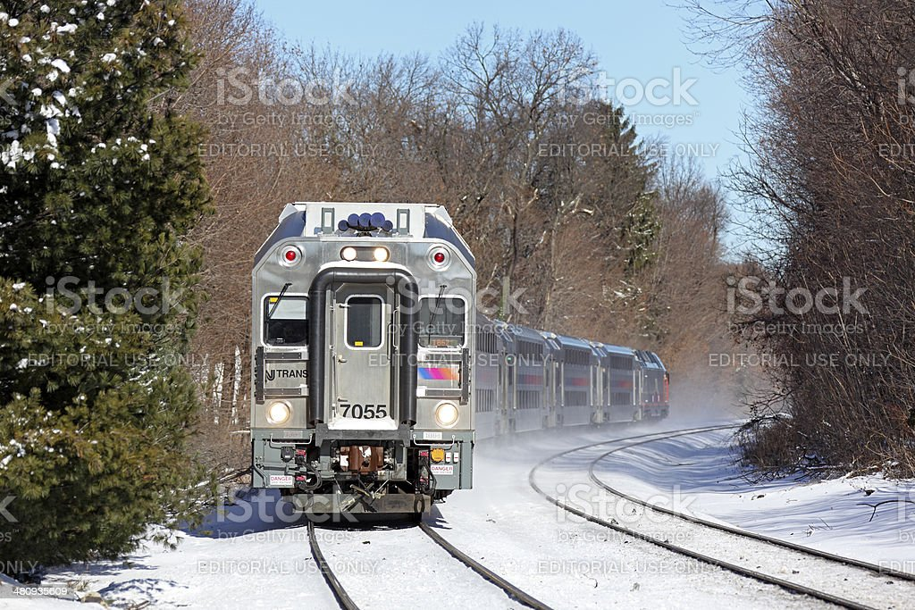 Double-decker NJ Transit commuter train in winter snow stock photo