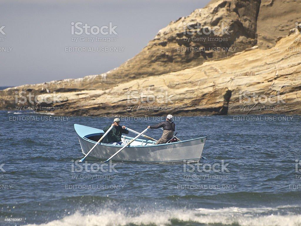 Double-end Rowing Dory Boat Returning Cape Kiwanda Pacific City Oregon royalty-free stock photo