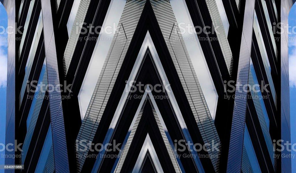 Double-exposure photo of metal panels resembling skyscraper fragment in twilight stock photo