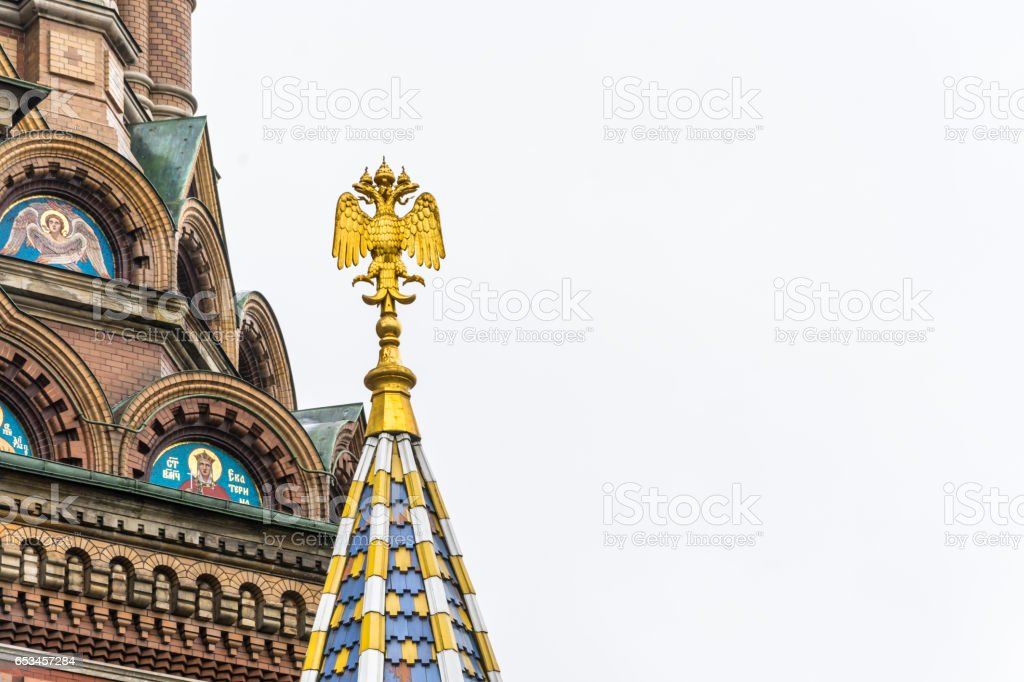 Double-headed eagle on the tower of the Church of the Savior on Blood in Saint-Petersburg, Russia. stock photo