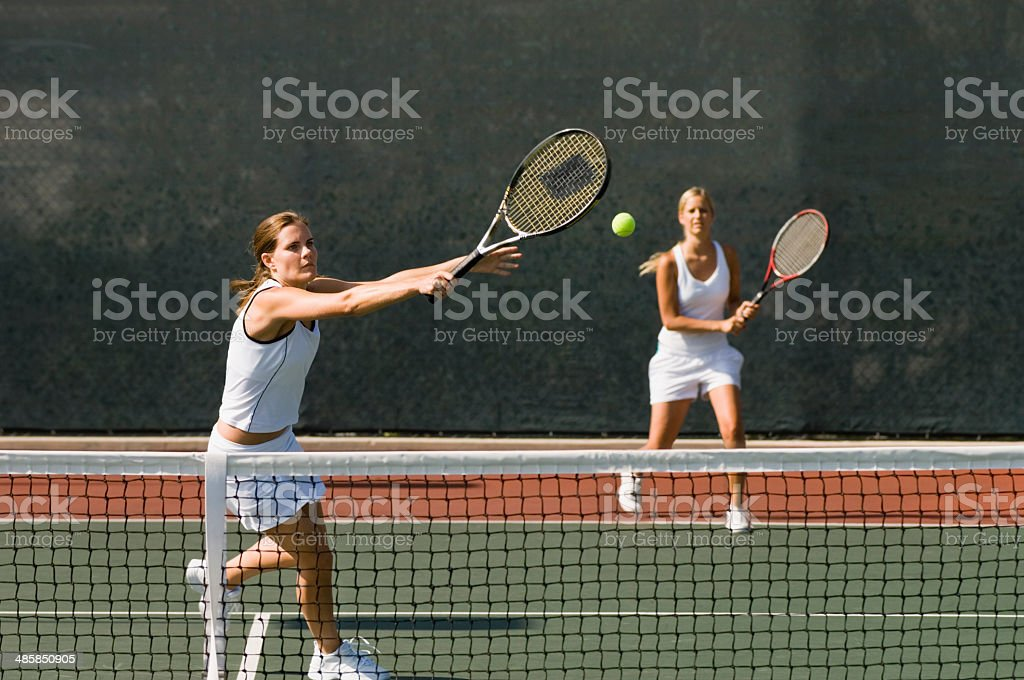Doubles Player Hitting Backhand stock photo