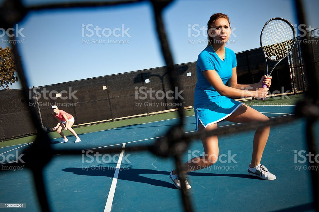Doubles Team Tennis Players Ready For Serve royalty-free stock photo