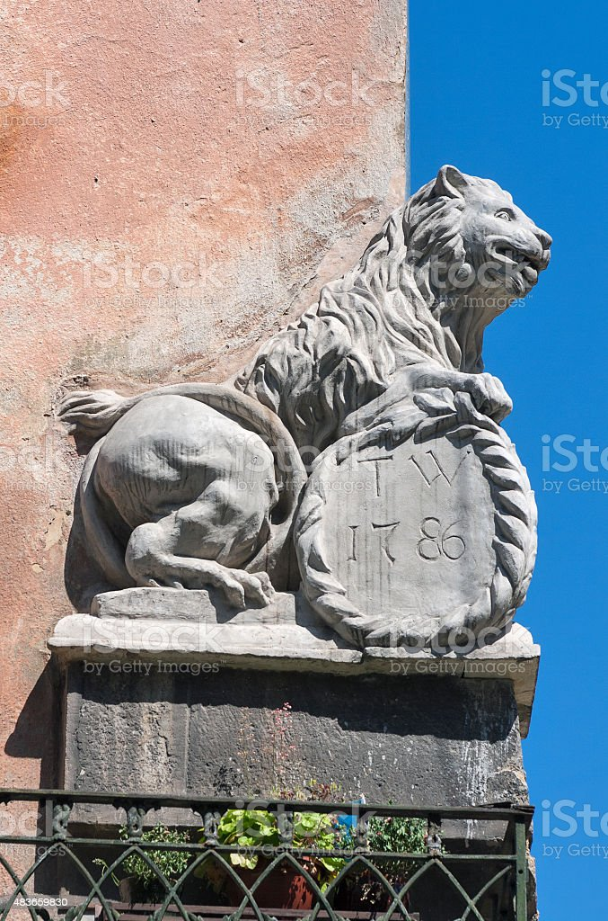 double-sided split statue of a lion on the house corner stock photo