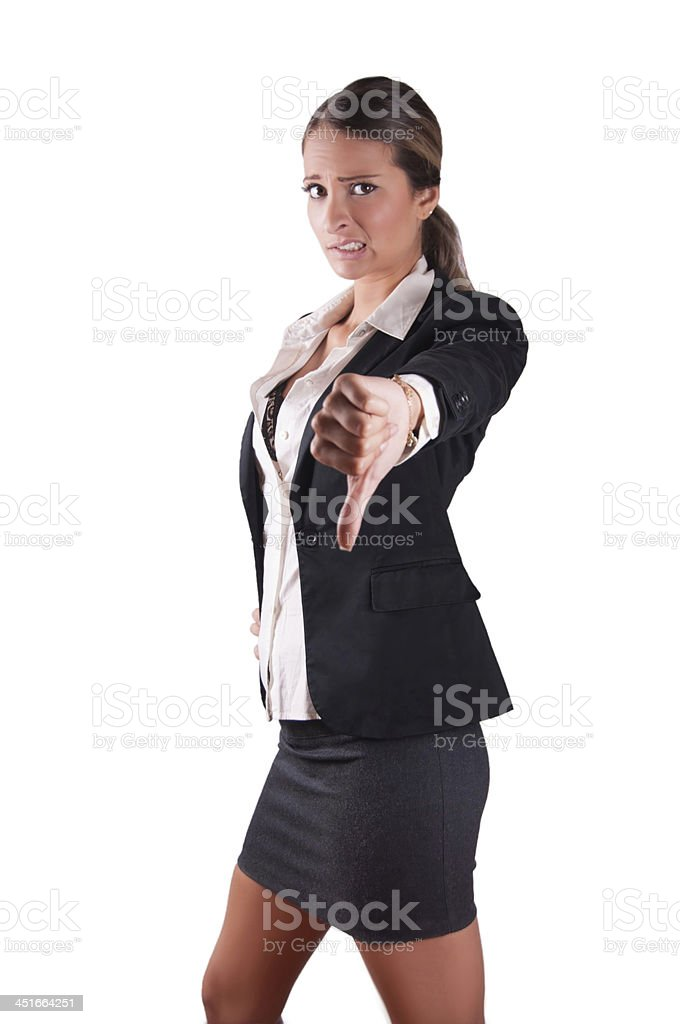 Doubtfull unsure uncertain corporate woman giving thumbs down stock photo